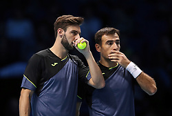Croatia's Ivan Dodig (right) and Spain's Marcel Grannollers during their doubles match during day two of the NITTO ATP World Tour Finals at the O2 Arena, London. PRESS ASSOCIATION Photo. Picture date: Monday November 13, 2017. Photo credit should read: John Walton/PA Wire. RESTRICTIONS: Editorial use only, No commercial use without prior permission