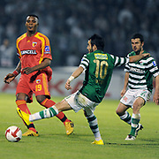 Bursaspor's Volkan SEN (C), Ali TANDOGAN (R) and Kayserispor's Aziza MAKUKULA (L)during their Turkish soccer super league match Bursaspor between Kayserispor at Ataturk Stadium in Bursa Turkey on Saturday, 01 May 2010. Photo by TURKPIX