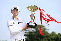 March 3, 2019 - Singapore - Sung Hyun Park of South Korea holds the winners trophy on the 18th hole after her victory in the Women's World Championship at the Tanjong Course, Sentosa Golf Club. (Credit Image: © Paul Miller/ZUMA Wire)