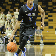 ORLANDO, FL - DECEMBER 31:  Shaquille Harrison #3 of the Tulsa Golden Hurricane dribbles the ball up court during an NCAA basketball game against the UCF Knights at the CFE Arena on December 31, 2014 in Orlando, Florida. (Photo by Alex Menendez/Getty Images) *** Local Caption *** Shaquille Harrison