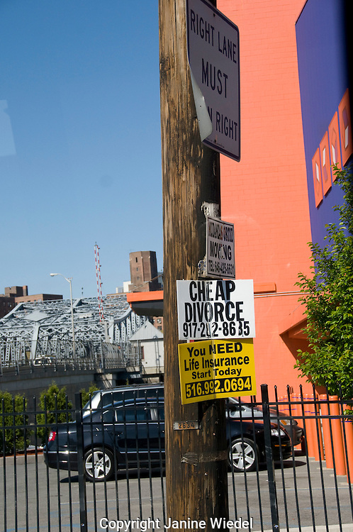 Advertisement for quick devorce on street post in New York City