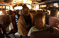 New arrivals wait in the bus after and eighteen hours trip from Khartoum to this city of Malakal.  More the 50 thousand south sudanese people has crossed this border point as life in the North became to difficult for them.  Analyst expect that more then one million people could try to cross as more then 2.5 million  are still living in the north.  Malakal city, UN and NGO's are already over stretched. (PHOTO: MIGUEL JUAREZ LUGO).