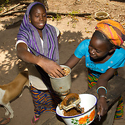 Koumbadiouma women grind peanuts to make peanut butter. Kolda, Senegal.