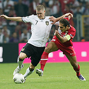 Turkey's Hamit ALTINTOP (R) and Germany's Bastian SCHWEINSTEIGER (L) during their UEFA EURO 2012 Qualifying round Group A matchday 19 soccer match Turkey betwen Germany at TT Arena in Istanbul October 7, 2011. Photo by TURKPIX