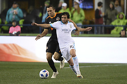 October 8, 2018 - Seattle, Washington, U.S - Houston midfielder ANDREW WENGER (11) puts pressure on Seattle's NICO LODEIRO (10) as the Houston Dynamo visits the Seattle Sounders in a MLS match at Century Link Field in Seattle, WA. Seattle won the match 4-1. (Credit Image: © Jeff Halstead/ZUMA Wire)