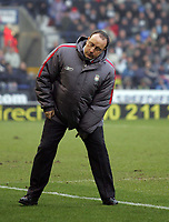 Photo: Paul Thomas.<br />Bolton Wanderers v Liverpool. The Barclays Premiership.<br />02/01/2006.<br />Liverpool manager Rafael Benitez has a stretch.