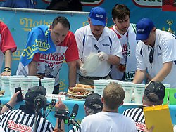 Joey Chestnut (L) competes during the men's competition of the Nathan's Hot Dog Eating Contest at Coney Island of New York City, NY, USA, on July 4, 2018. Joey Chestnut set a new world record Wednesday by devouring 74 hot dogs in 10 minutes at the Nathan's Hot Dog Eating Contest in New York. Miki Sudo defended the women's title by eating 37 hot dogs in 10 minutes. Photo by Dennis Van Tine/ABACAPRESS.COM