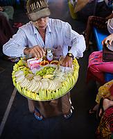 YANGON, MYANMAR - CIRCA DECEMBER 2017: Fruit seller at the Yangon circular railway service.