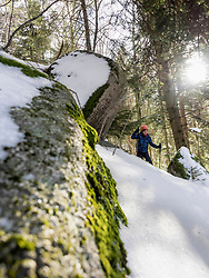 Low angle view of a Girl snowshoeing in Black Forest, Germany, Europe