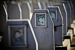 Photos of deceased PKK members are displayed on gravestones at Mehmet Karasungur Cemetery, one of PKK graveyard, in Qandil Mountains, Iraqi Kurdistan.