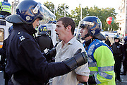 London, England, 15/09/2004..An estimated 20,000 hunt supporters demonstrate in Parliament Square as a new bill to ban hunting with dogs is passed. Some demonstrators fought with riot police, and five hunt supporters managed to get onto the House of Commons floor during the debate..Demonstrator arrested during fighting with police around Parliament.