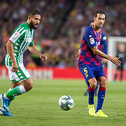 BARCELONA, SPAIN - August 25:  Sergio Busquets #5 of Barcelona passes the ball past Nabil Fekir #8 of Real Betis during the Barcelona V  Real Betis, La Liga regular season match at  Estadio Camp Nou on August 25th 2019 in Barcelona, Spain. (Photo by Tim Clayton/Corbis via Getty Images)