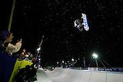 Spectators watch Shawn White compete in the U.S. Snowboarding Grand Prix finals, Friday, Jan. 22, 2010, in Park City, Utah. (AP Photo/Colin E Braley)