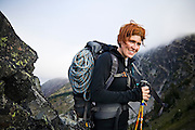 Portrait of Veronika Glukhova carrying a climbing rope to the base of Mount Stuart, Alpine Lakes Wilderness, Washington.