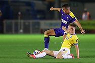 AFC Wimbledon midfielder Anthony Hartigan (8) battles with Brighton and Hove Albion midfielder Ed Turns (72) during the EFL Trophy Southern Group G match between AFC Wimbledon and Brighton and Hove Albion U21 at The People's Pension Stadium, Crawley, England on 22 September 2020.