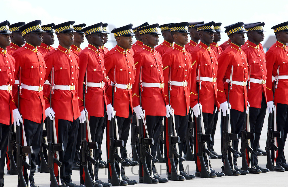 Military Guard Of Honour of Jamaica Defence Force with rifles and bayonets outside Parliament in Kingston, Jamaica