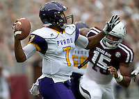Prairie View A&M quarterback Trey Green (7) looks to pass as he is pressured by Texas A&M defensive lineman Myles Garrett (15) during the first quarter of an NCAA college football game Saturday, Sept. 10, 2016, in College Station, Texas. (AP Photo/Sam Craft) of an NCAA college football game Saturday, Sept. 10, 2016, in College Station, Texas. (AP Photo/Sam Craft)