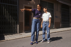 Woman standing in street in Gerona; Catalunya; giving directions to young boy,