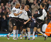 Andy Cole (centre) celebrates putting Fulham 1-0 ahead with Zesh Rehman, Mark Pembridge and Carlos Bocanegra. Fulham v Crystal Palace, FA Barclaycard Premiership, 1/01/2005. Credit: Back Page Images / Matthew Impey