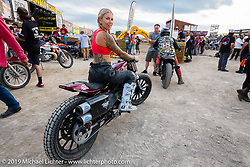 Model and Hooligan flattracker (no. 57) Stephanie Pietz on her Harley-Davidson Sportster racer on the track in front of the main stage at the Sturgis Buffalo Chip during the Sturgis Black Hills Motorcycle Rally. SD, USA. Wednesday, August 7, 2019. Photography ©2019 Michael Lichter.