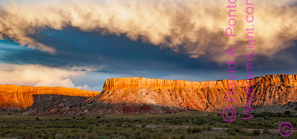 Sunset light on storm clouds over White Mesa, New Mexico, © David A. Ponton