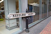 Street sign for Needless Alley in central Birmingham, United Kingdom. Needless Alley is a little passage north off New Street. From the late 18th century Birmingham's planners set about removing passages, and alleys, seeing as them as useless for commerce, and unsavoury. The survival of the alleyway was certainly never assured. In 1829, the Birmingham Journal said it was 'needless by name and needless by nature'.
