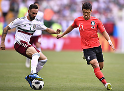 ROSTOV-ON-DON, June 23, 2018  Hwang Heechan (R) of South Korea vies with Miguel Layun of Mexico during the 2018 FIFA World Cup Group F match between South Korea and Mexico in Rostov-on-Don, Russia, June 23, 2018. (Credit Image: © Chen Yichen/Xinhua via ZUMA Wire)