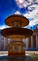 """""""Bernini fountain in Piazza San Pietro - Vatican""""...<br /> <br /> This image was created at the Vatican in the Piazza of Saint Peter of the famous Bernini fountain located in the southern area of the square.  There are two fountains in St. Peter's Square:  the first was created by Carlo Maderno; the other by Gian Lorenzo Bernini, the Italian sculptor and architect, and a major historical figure in the world of architecture. He was the leading sculptor of his age, credited with creating the Baroque style of sculpture, and he was also the designer of the entire square of Saint Peters.  Pope Alexander VII trusted Bernini to develop a structure that would adequately frame a barrier of space for visitors to collect, but also a place for them to bask in the honor and distinction of Rome as a Catholic state. Bernini placed ninety-six saintly statues over the colonnade's balustrade, which tower majestically over the square, and are viewable in the background of the fountain."""