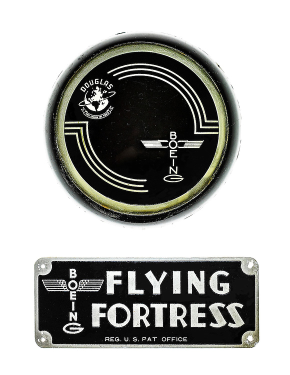 A yoke medallion and ID plate from a Douglas manufactured Boeing B-17 bomber.