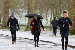 © Licensed to London News Pictures. 08/02/2021. London, UK. People brave the snow, freezings temperatures and strong winds in Finsbury Park, north London. The Met Office has issued yellow warnings for snow as cold air from Russia and Eastern Europe continues across the UK. Photo credit: Dinendra Haria/LNP