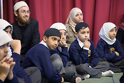 Children sitting in the assembly hall at the Nottingham Islamia school,