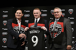 English international soccer player Wayne Rooney flanked by Jason Levien (L) , United Managing Partner and CEO , and Dave Kasper , United General Manager and VP of Soccer Operations pose during the media unveiling at the Newseum in Washington, DC.