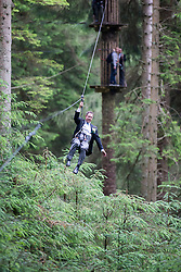 Martin Milner after tying the knot in the trees at Go Ape Aberfoyle, heading down another zip wire, after the climbing net.