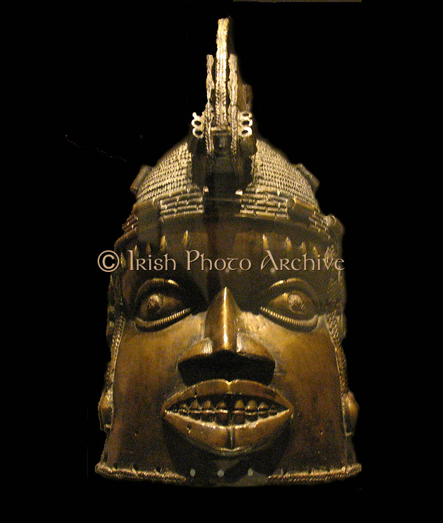 Brass helmet mask for the Ododua ritual, Benin, Nigeria.  Edo peoples, 18th century AD.  In addition to his executive powers and duties, the OBA (king) of Benin also performed a number of rituals throughout the year.