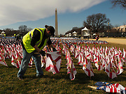 On the morning after the Inauguration, workers removed the 200,000 flags planted on the National Mall, such as these from Florida, to fill in for the thousands of people who could not attend because of the coronavirus pandemic and tight security. The flags represented the 50 states, the District of Columbia, and the five U.S. territories of American Samoa, Guam, Northern Mariana Islands, Puerto Rico and the U.S. Virgin Islands.