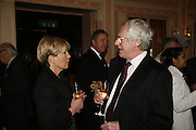 CANDIDA LYCETT GREEN AND BARRY NORMAN , Oldie magazine's Oldie of the Year Awards 2006. Simpson's. the Strand. London.21 March 2006.  ONE TIME USE ONLY - DO NOT ARCHIVE  © Copyright Photograph by Dafydd Jones 66 Stockwell Park Rd. London SW9 0DA Tel 020 7733 0108 www.dafjones.com