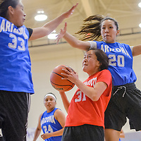 040314       Cable Hoover<br /> <br /> New Mexico's Taylor Henderson (31) ducks under a block attempt from Arizona players Brooke Curleyhair (20) and Shaniya Betsoi (33) during the Arizona New Mexico Allstars match at Miyamura High School Thursday.