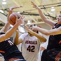 Gallup Bengal Troy Etsitty (42) competes with Aztec Tigers Cody Smith (11) and Chase Morrison (23) for a rebound Tuesday at Gallup High School.