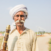 CAPTION: Sudama Rai, a senior figure in the locality of the OORJAgram Rural Enterprise Zone. LOCATION: Diara Rasulpur, Saran District, Bihar, India. INDIVIDUAL(S) PHOTOGRAPHED: Sudama Rai.