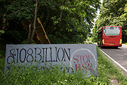 A painted sign criticising the cost of the HS2 high-speed rail link is pictured alongside the A413 outside Stop HS2s Wendover Active Resistance Camp on 16th June 2021 in Wendover, United Kingdom. Large areas of land around Wendover in the Chilterns AONB have already been cleared of trees and vegetation for the rail infrastructure project in spite of concerted opposition from local residents and environmental activists.