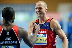 07-02-2010 ATLETIEK: NK INDOOR: APELDOORN<br /> Gregory Sedoc Nederlands kampioen 60 m horden wordt gefeliciteerd door Marcel van der Westen<br /> ©2010-WWW.FOTOHOOGENDOORN.NL