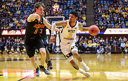 Jan 12, 2019; Morgantown, WV, USA; West Virginia Mountaineers guard James Bolden (3) drives towards the basket during the second half against the Oklahoma State Cowboys at WVU Coliseum. Mandatory Credit: Ben Queen-USA TODAY Sports