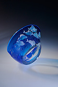 Hand made glass sculpture, made by Scottish Borders based artist Julia Linstead. Hand-blown 24% lead crystal bowl and platters in jewel colours. Each piece is unique, with a hand-drawn design sandblasted into the coloured surface. This style of etching produces a painted effect complementing the natural themes of the patterns. Designs include flowers, dragonflies and aquatic life such as seahorses, penguins and fish. Julia also produces one-offs and commissions.