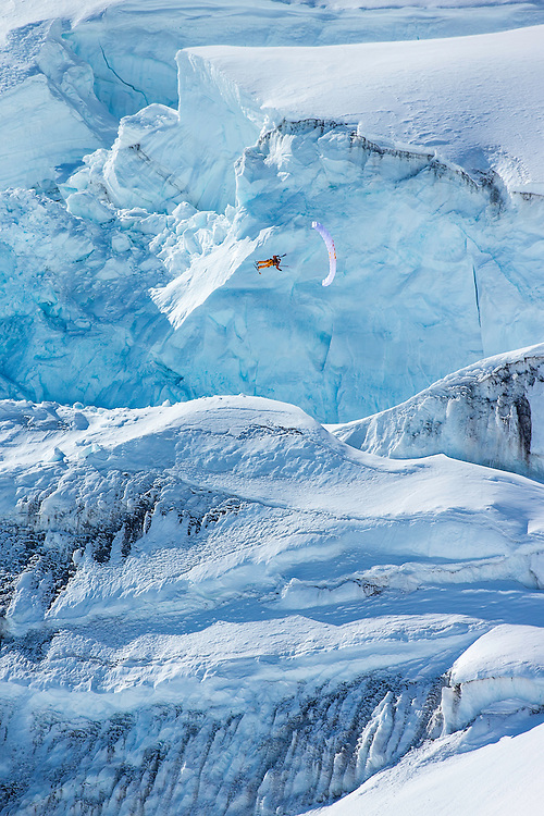 Jon Devore jumps off a large glacier while filming for the Unrideables in the Tordrillo Mountains near Anchorage, Alaska on April 21th, 2014.