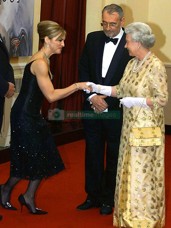 File photo dated 18/11/2002 of Queen Elizabeth II meeting Madonna at the World Premiere of new James Bond film Die Another Day, in which the American star has a leading role, at the Royal Albert Hall. The pop superstar will celebrate her 60th birthday on Thursday, following a long career of reinvention and controversy.
