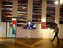 © Licensed to London News Pictures. 13/08/2020. York, UK.  A visitor walks past US President Donald Trump on screen as part of Bill Poster and Daniel Howe's work called Big Dada (fake news) as part of The Aesthetica Art Prize at York Art Gallery 13 August 2020.  18 contemporary artist with work that respond to key issues in todays digital world have pieces on display for The annual Aesthetica Art Prize at the Gallery until February 2021.  Photo credit: Nigel Roddis/LNP