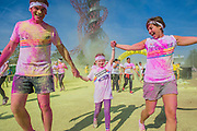 """The Color Run at the Queen Elizabeth Olympic Park - runners of all ages, shapes and sizes take part in a 5k fun run organised by Dulux in aid of Save thae Children. At each kilometre of the course coloured powder covers runners as they pass the  Olympic and Paralympic Games venues, before DJs entertain them  in the Color Festival Area at the finish line. According to the organisers it is – """"Known as the happiest 5k on the planet, The Color Run is an un-timed celebration of health and colour, meaning groups of friends can walk, jog, dance and party their way along the course at any pace."""" The colour used at the events is made from food grade cornstarch. It is 100% natural and causes no harm to skin or the environment."""