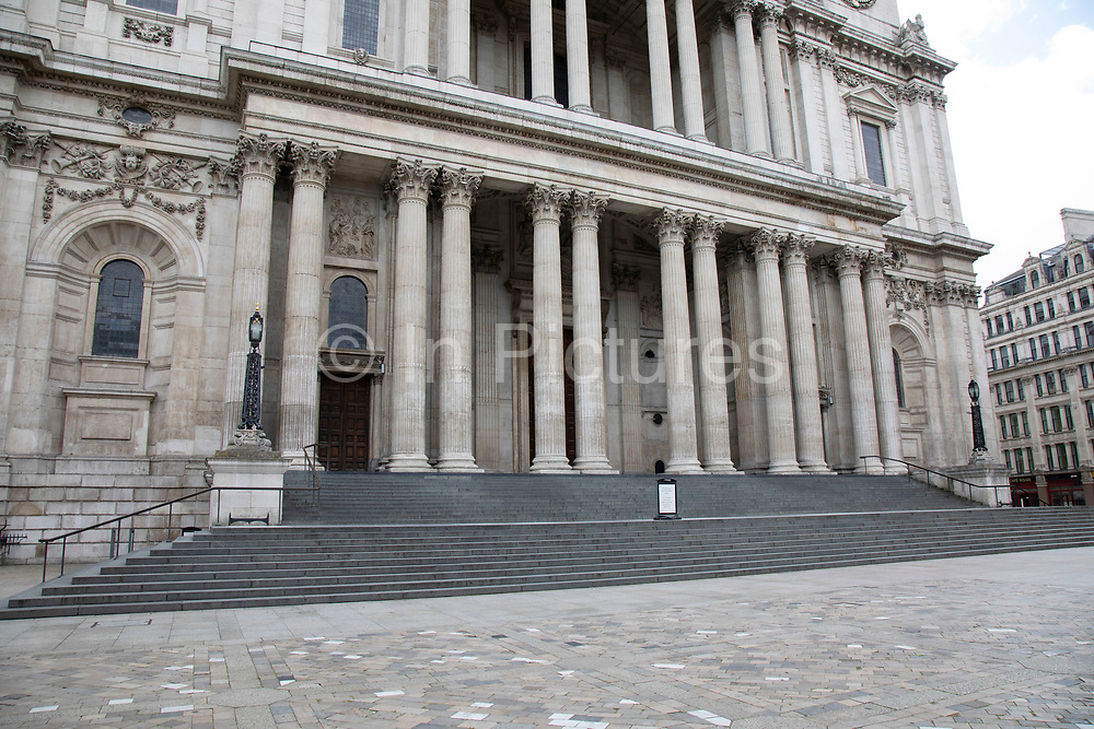 View looking at the empty steps of St Pauls Cathedral, which is eerily quiet and silent on empty streets as lockdown continues and people observe the stay at home message in the capital on 11th May 2020 in London, England, United Kingdom. Coronavirus or Covid-19 is a new respiratory illness that has not previously been seen in humans. While much or Europe has been placed into lockdown, the UK government has now announced a slight relaxation of the stringent rules as part of their long term strategy, and in particular social distancing.
