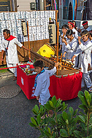 Japanese Musicians at Mengake Kamakura - Mengake or Masked Parade at Goryo Jinja shrine.  At this festival held in September a group of ten people take part in this annual ritual: 8 men and 2 women. Wearing comical or grotesque masks that signify different demons, legends and dieties  leave the shrine and parade through the nearby streets accompanied by portable shrine and festival music.