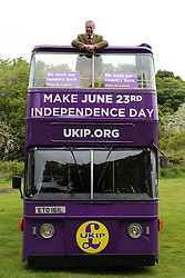 © Licensed to London News Pictures. 25/05/2016. Chapeltown, UK. Nigel Farage atop the UKIP Referendum open top bus in Chapeltown, South Yorkshire. The party's purple open top battle bus is touring the country in the run up to the EU referendum. There is just a month to go until the UK's referendum on it's membership of the European Union. Poll stations will open their doors on Thursday 23 June. Photo credit : Ian Hinchliffe/LNP